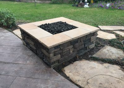 Primo_Outdoor_Living_Gas_Fire_Pit_with_Black_Lava_Rock_over_24_inch_Fire_Ring_1