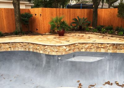 Primo_Outdoor_Living_Pool_Remodel_with_Travertine_Deck__Coping__Split_Face_Veneer__Tile__and_New_Plaster